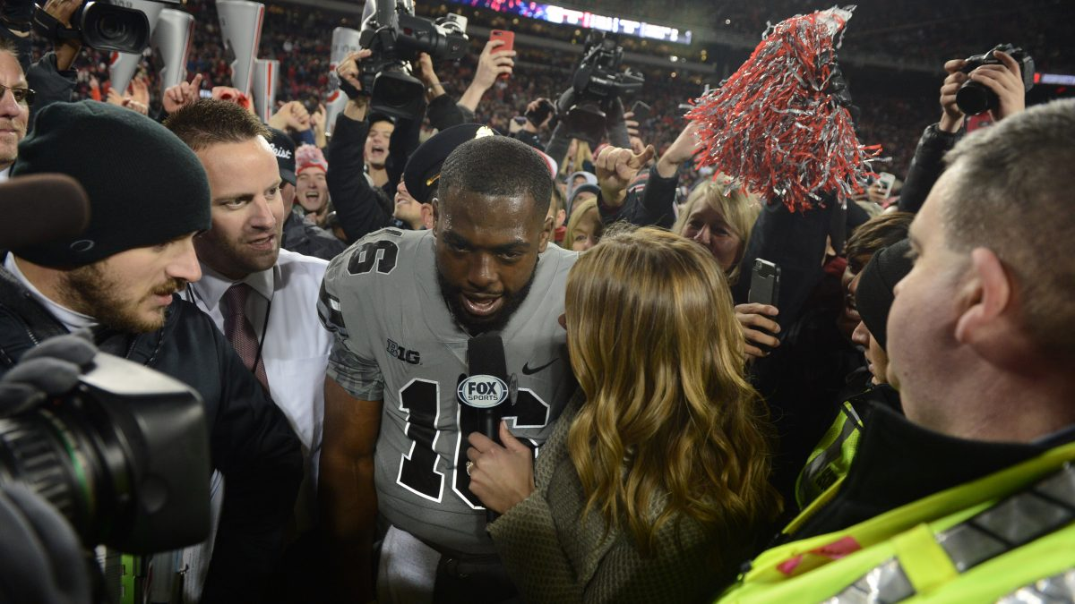 Jenny Taft with Ohio State QB J.T. Barrett