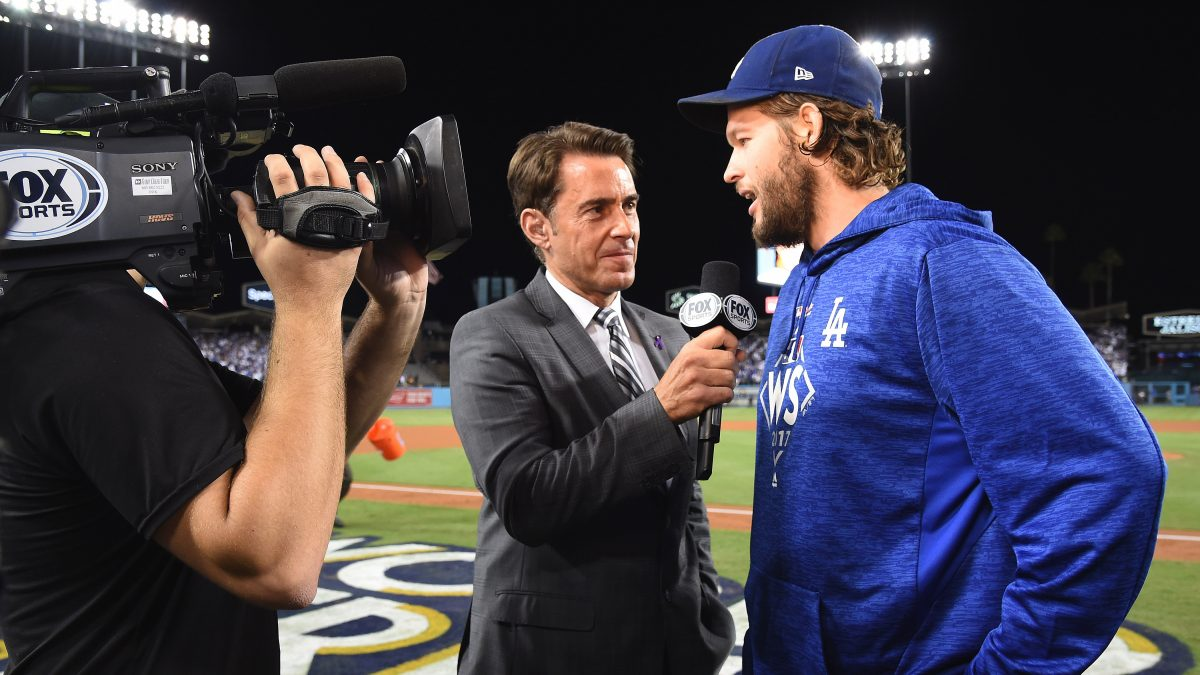 LOS ANGELES - OCTOBER 24:  Tom Verducci and Clayton Kershaw at The World Series on Fox - Game 1 - Houston Astros vs Los Angeles Dodgers at Dodger Stadium on October 24, 2017 in Los Angeles, California. (Photo by Frank Micelotta/Fox/PictureGroup)