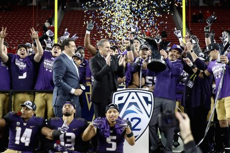 SANTA CLARA, CA - NOVEMBER 30:  Head coach Chris Petersen of the Washington Huskies is given the championship trophy after the Huskies beat the Utah Utes to win the Pac 12 Championship game at Levi's Stadium on November 30, 2018 in Santa Clara, California.  (Photo by Ezra Shaw/Getty Images)