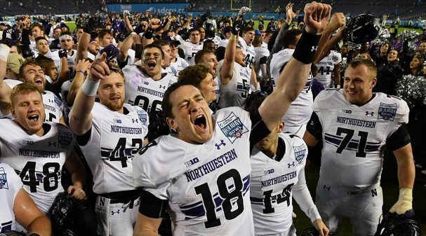 SAN DIEGO, CA - DECEMBER 31: Northwestern Wildcats quarterback Clayton Thorson (18) celebrates on the field with his team after the Wildcats defeated the Utah Utes 31 to 20 to become the 2018 Holiday Bowl champions, on December 31, 2018 at SDCCU Stadium in San Diego, CA. (Photo by John Cordes/Icon Sportswire via Getty Images)