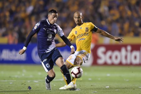 MONTERREY, MEXICO - APRIL 23: Rogelio Funes Mori, #7 of Monterrey, fights for the ball with Hugo Ayala, #4 of Tigres,  during the final first leg match between Tigres UANL and Monterrey as part of the CONCACAF Champions League 2019 at Universitario Stadium on April 23, 2019 in Monterrey, Mexico. (Photo by Azael Rodriguez/Getty Images)