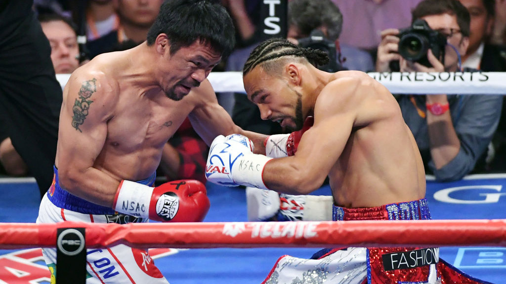 LAS VEGAS, NEVADA - JULY 20:  Manny Pacquiao (L) and Keith Thurman battle in the first round of their WBA welterweight title fight at MGM Grand Garden Arena on July 20, 2019 in Las Vegas, Nevada. Pacquiao won in a split decision.  (Photo by Ethan Miller/Getty Images)