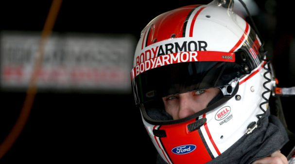 KANSAS CITY, KS - MAY 10:  Ryan Blaney, driver of the #12 BodyArmor Ford, stands in the garage during practice for the Monster Energy NASCAR Cup Series Digital Ally 400 at Kansas Speedway on May 10, 2019 in Kansas City, Kansas.  (Photo by Sean Gardner/Getty Images)