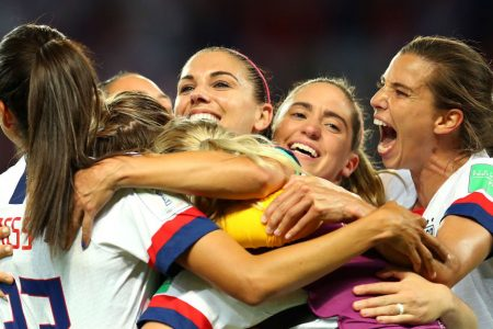 PARIS, FRANCE - JUNE 28: Christen Press, Alex Morgan, Morgan Brian, and Tobin Heath celebrate after the 2019 FIFA Women's World Cup France Quarter Final match between France and USA at Parc des Princes on June 28, 2019 in Paris, France. (Photo by Maddie Meyer - FIFA/FIFA via Getty Images)