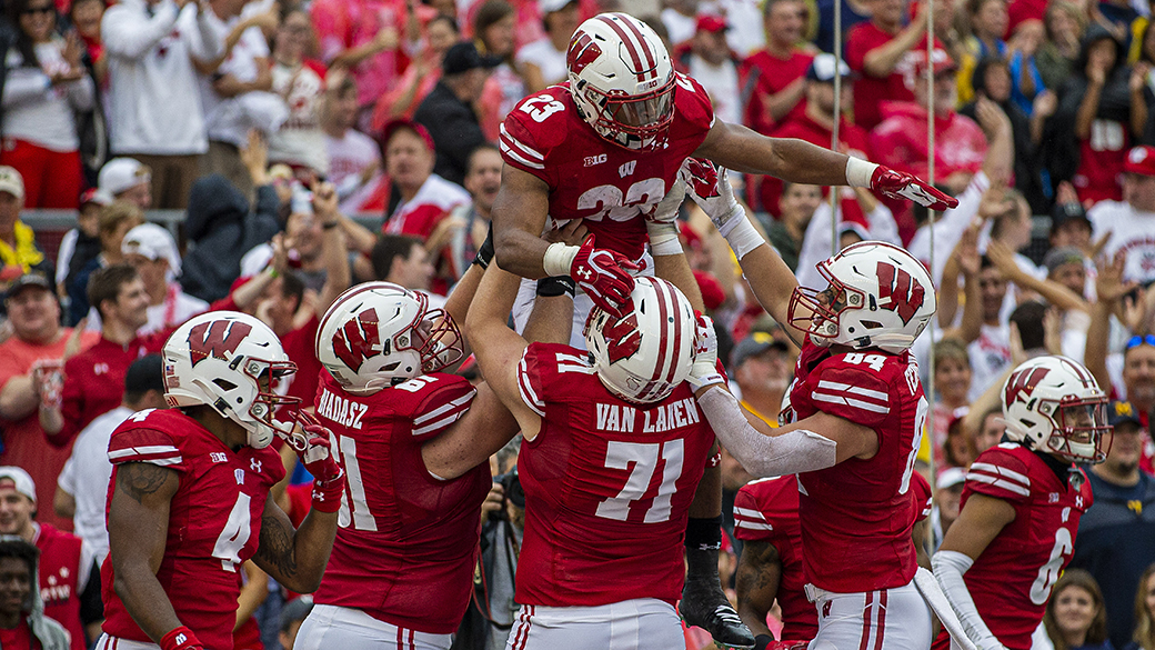 MADISON, WI - SEPTEMBER 21: Wisconsin Badgers running back Jonathan Taylor (23) celebrates with teammates after scoring on a long touchdown run durning a college football game between the Michigan Wolverines and the Wisconsin Badgers on September 21, 2019, at Camp Randall Stadium in Madison, WI. (Photo by Dan Sanger/Icon Sportswire via Getty Images)