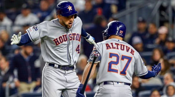 NEW YORK, NEW YORK - OCTOBER 17:  George Springer #4 of the Houston Astros is congratulated by his teammate Jose Altuve #27 after hitting a three-run home run against the New York Yankees during the third inning in game four of the American League Championship Series at Yankee Stadium on October 17, 2019 in New York City. (Photo by Mike Stobe/Getty Images)