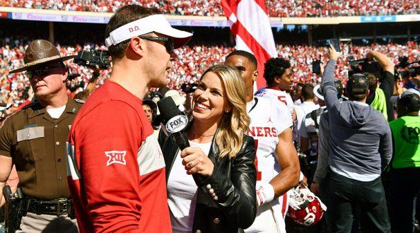 Jenny Taft with Oklahoma Head Coach Lincoln Riley