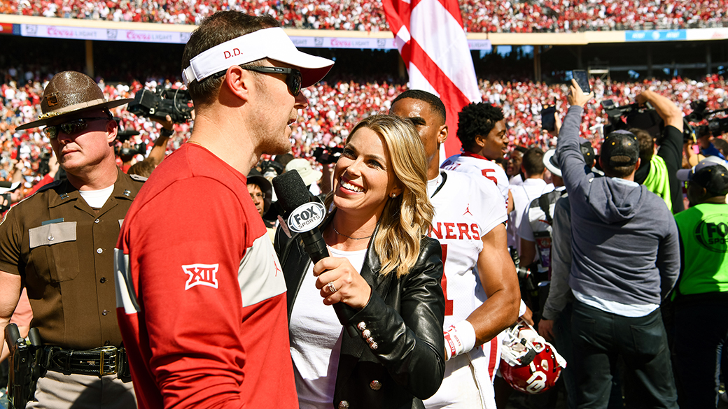 Jenny Taft with Oklahoma Head Coach Lincoln Riley
