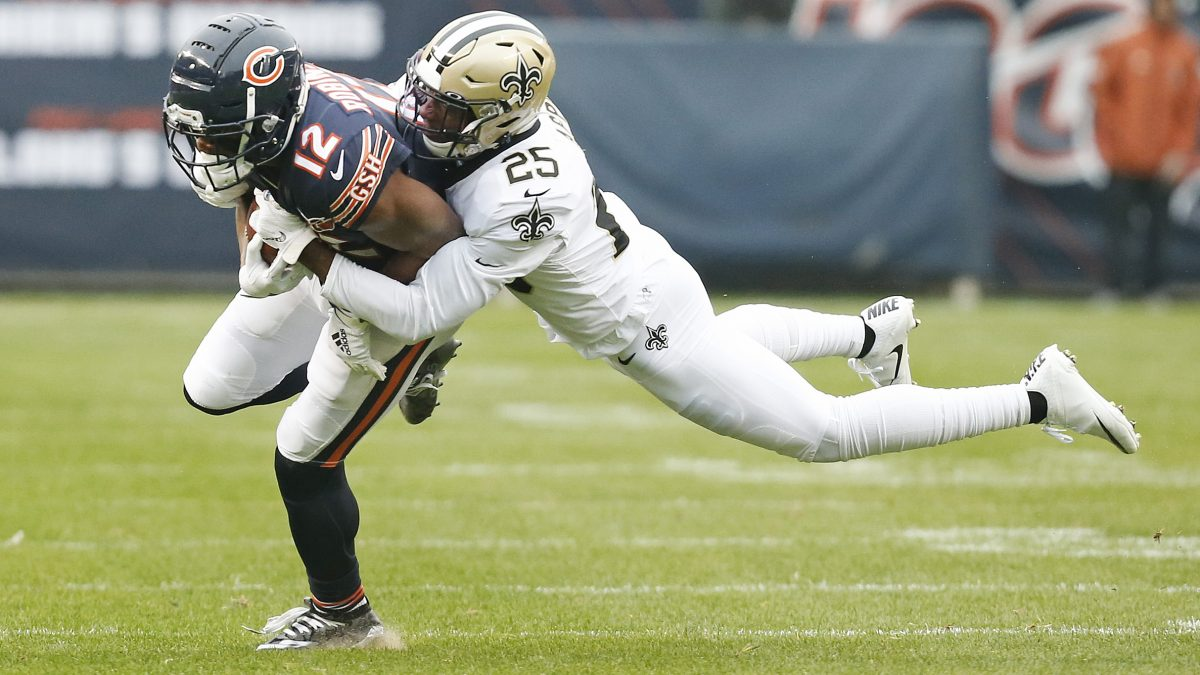 CHICAGO, ILLINOIS - OCTOBER 20: Allen Robinson #12 of the Chicago Bears is tackled by Eli Apple #25 of the New Orleans Saints during the first half at Soldier Field on October 20, 2019 in Chicago, Illinois. (Photo by Nuccio DiNuzzo/Getty Images)