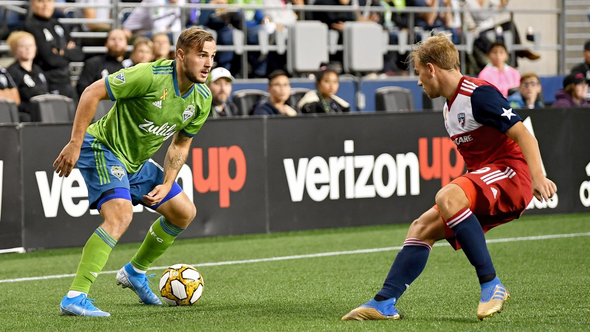 SEATTLE, WASHINGTON - SEPTEMBER 18: Jordan Morris #13 of Seattle Sounders looks to move the ball against Alex Muyl #19 of New York Red Bulls during the match at CenturyLink Field on September 18, 2019 in Seattle, Washington. The match ended in a 0-0 draw. (Photo by Alika Jenner/Getty Images)