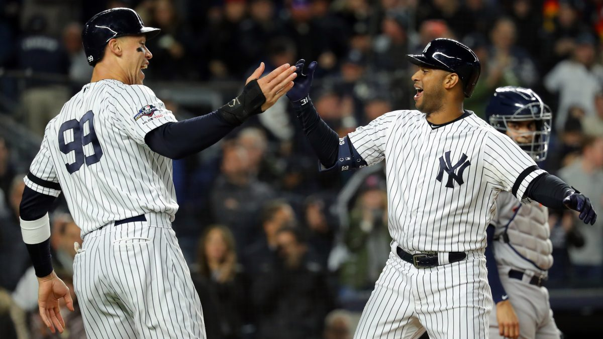 BRONX, NY - OCTOBER 18:  Aaron Hicks #31 of the New York Yankees is greeted by teammate Aaron Judge #99 after hitting a three-run home run in the first inning during Game 5 of the ALCS between the Houston Astros and the New York Yankees at Yankee Stadium on Friday, October 18, 2019 in the Bronx borough of New York City. (Photo by Alex Trautwig/MLB Photos via Getty Images)