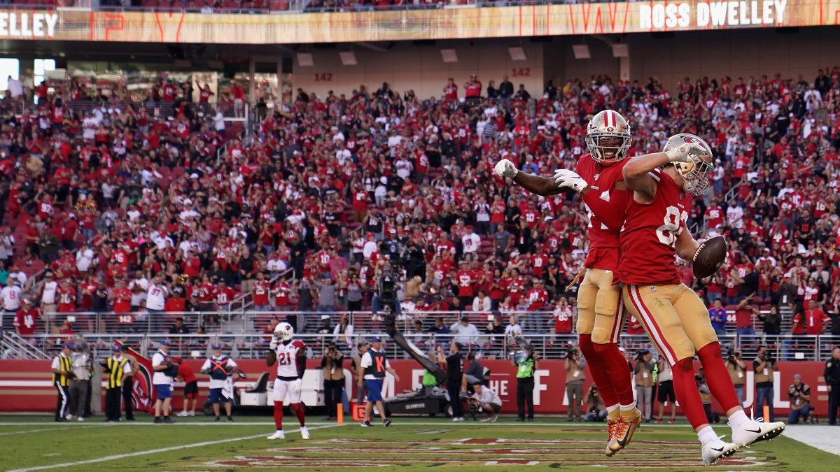 SANTA CLARA, CALIFORNIA - NOVEMBER 17: Tight end Ross Dwelley #82 of the San Francisco 49ers celebrates with Kendrick Bourne #84 after scoring on a five yard touchdown reception against the Arizona Cardinals during the second half of the NFL game at Levi's Stadium on November 17, 2019 in Santa Clara, California. (Photo by Thearon W. Henderson/Getty Images)
