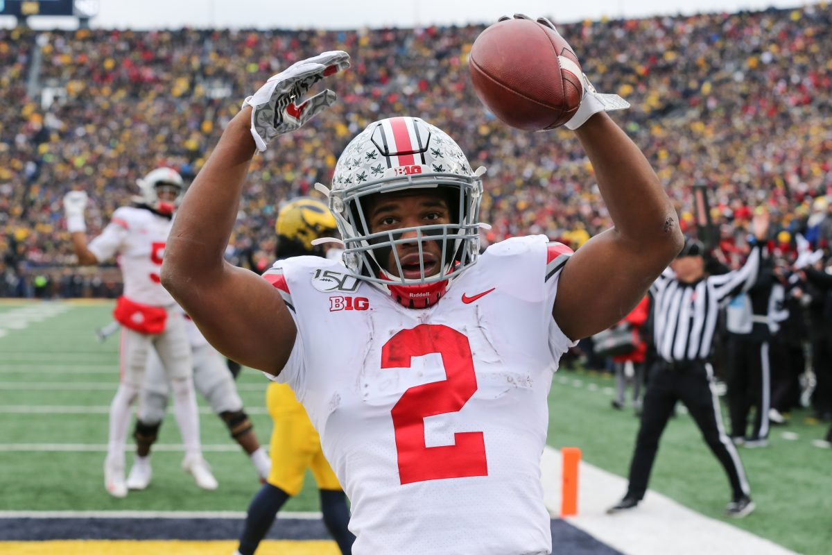 ANN ARBOR, MI - NOVEMBER 30:  Ohio State Buckeyes running back J.K. Dobbins (2) celebrates in the end zone after scoring a touchdown during a regular season Big 10 Conference game between the Ohio State Buckeyes (2) and the Michigan Wolverines (10) on November 30, 2019 at Michigan Stadium in Ann Arbor, Michigan. (Photo by Scott W. Grau/Icon Sportswire via Getty Images)