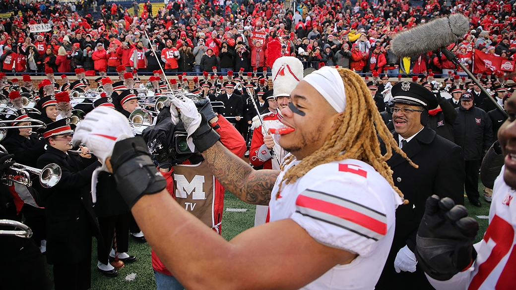 ANN ARBOR, MI - NOVEMBER 30: Chase Young #2 of the Ohio State Buckeyes leads the Ohio State Marching Band in song after the win over the Michigan Wolverines at Michigan Stadium on November 30, 2019 in Ann Arbor, Michigan. Ohio State defeated Michigan 56-27. (Photo by Leon Halip/Getty Images)