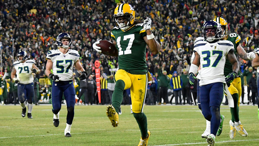 GREEN BAY, WISCONSIN - JANUARY 12: Davante Adams #17 of the Green Bay Packers runs in a 40-yard touchdown catch against the Seattle Seahawks in the third quarter of the NFC Divisional Playoff game at Lambeau Field on January 12, 2020 in Green Bay, Wisconsin. (Photo by Quinn Harris/Getty Images)