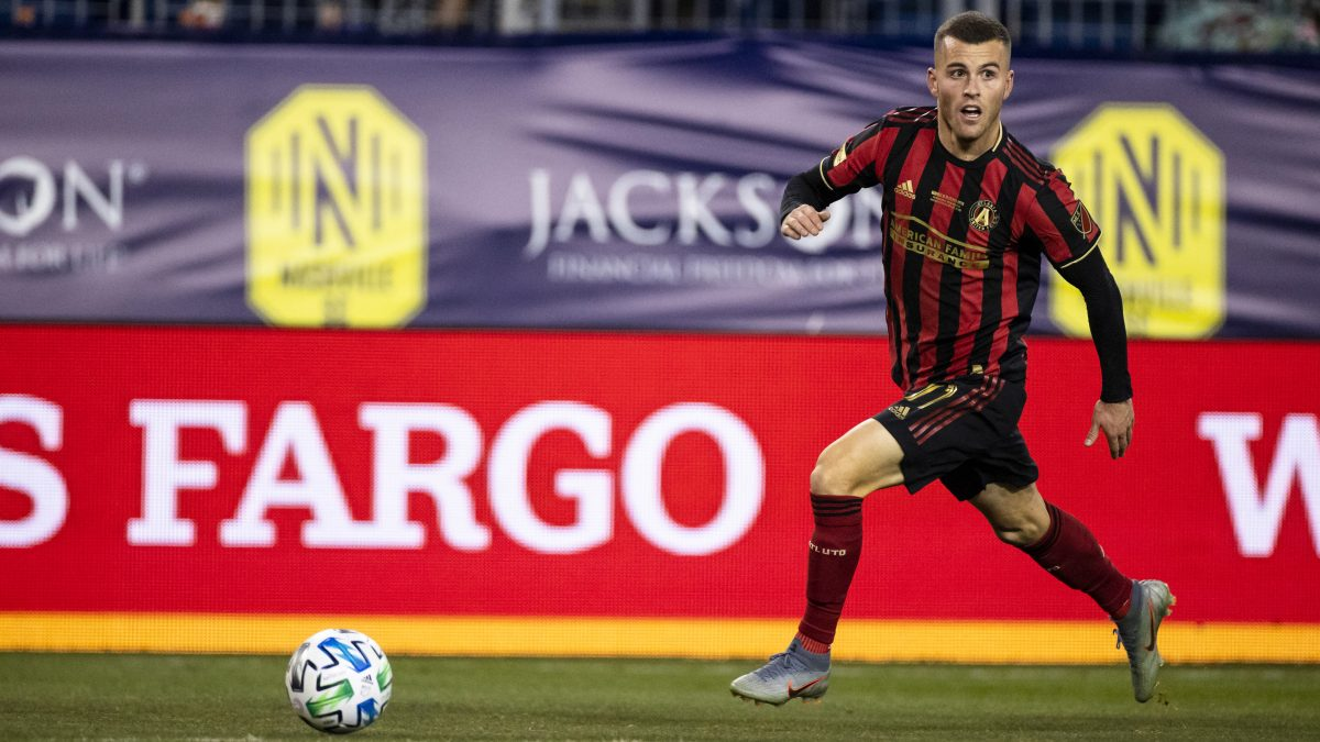 NASHVILLE, TN - FEBRUARY 29:  Brooks Lennon #11 of the Atlanta United sets up a cross against the Nashville SC during the second half at Nissan Stadium on February 29, 2020 in Nashville, Tennessee. Atlanta defeats Nashville 2-1. (Photo by Brett Carlsen/Getty Images)