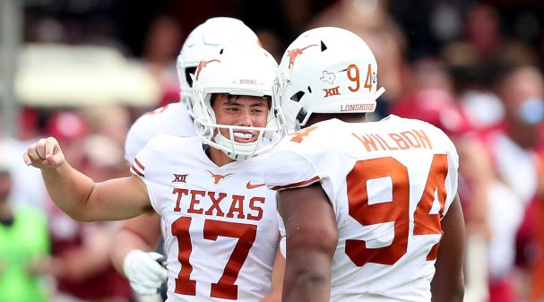 DALLAS, TX - OCTOBER 06:  Cameron Dicker #17 of the Texas Longhorns celebrates with Gerald Wilbon #94 of the Texas Longhorns after kicking the game-winning field goal against the Oklahoma Sooners during the 2018 AT&T Red River Showdown at Cotton Bowl on October 6, 2018 in Dallas, Texas.  (Photo by Tom Pennington/Getty Images)