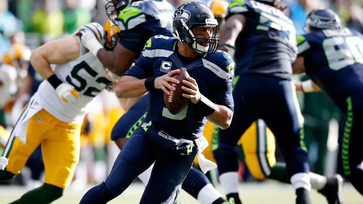 SEATTLE, WA - JANUARY 18:  Russell Wilson #3 of the Seattle Seahawks in action against the Green Bay Packers during the 2015 NFC Championship game at CenturyLink Field on January 18, 2015 in Seattle, Washington.  (Photo by Otto Greule Jr/Getty Images)