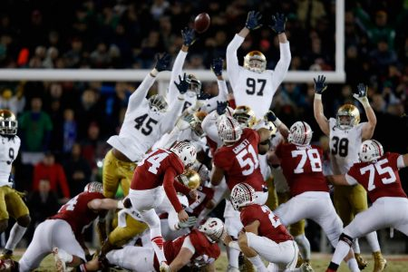 PALO ALTO, CA - NOVEMBER 28:  Conrad Ukropina #34 of the Stanford Cardinal kicks the game-winning field at the end of regulation to be the Notre Dame Fighting Irish  at Stanford Stadium on November 28, 2015 in Palo Alto, California.  (Photo by Ezra Shaw/Getty Images)