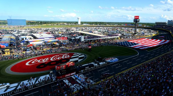 The American flag is unfurled along the front stretch of Charlotte Motor Speedway during pre-race festivities for the Coca-Cola 600 on Sunday, May 28, 2017. (Jeff Siner/Charlotte Observer/Tribune News Service via Getty Images)