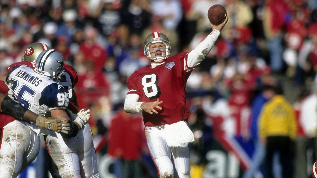 SAN FRANCISCO, CA - JANUARY 15, 1995:  Quarterback Steve Young #8 of the San Francisco 49ers throws a pass against the Dallas Cowboys during the NFL conference championship football game January 15, 1995 at Candlestick Park in San Francisco, California.  49ers won the game 38-28. Young played for the 49ers  from 1987-99. (Photo by Focus on Sport/Getty Images)