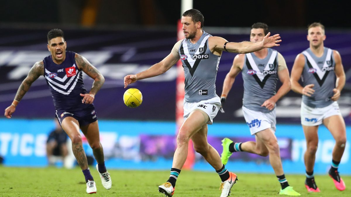 GOLD COAST, AUSTRALIA - JUNE 21: Travis Boak of the Power kicks during the round 4 AFL match between the Fremantle Dockers and Port Adelaide Power at Metricon Stadium on June 21, 2020 in Gold Coast, Australia. (Photo by Chris Hyde/Getty Images)
