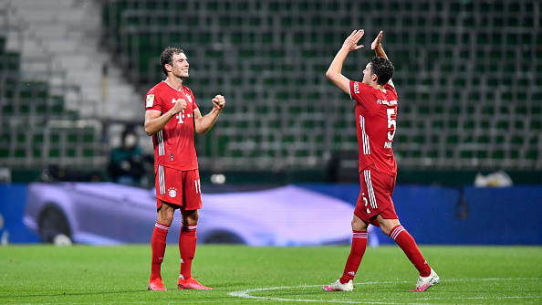 Bayern Munich's French defender Benjamin Pavard (R) celebrates with his teammate Bayern Munich's German midfielder Leon Goretzka after the German first division Bundesliga football match SV Werder Bremen v FC Bayern Munich on June 16, 2020 in Bremen, northern Germany. - Bayern Munich were crowned German Bundesliga champions for the eight year in a row on June 16, 2020 after their away win against Bremen. (Photo by Martin MEISSNER / POOL / AFP) / DFL REGULATIONS PROHIBIT ANY USE OF PHOTOGRAPHS AS IMAGE SEQUENCES AND/OR QUASI-VIDEO (Photo by MARTIN MEISSNER/POOL/AFP via Getty Images)