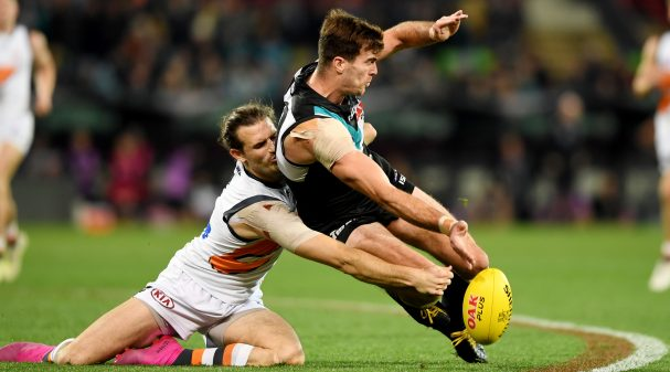 ADELAIDE, AUSTRALIA - JULY 27: Scott Lycett of Port Adelaide competes with Phil Davis of the Giants during the round 19 AFL match between the Port Adelaide Power and the Greater Western Sydney Giants at Adelaide Oval on July 27, 2019 in Adelaide, Australia. (Photo by Mark Brake/Getty Images)