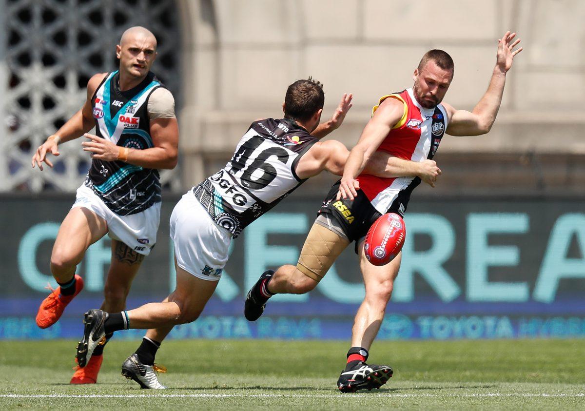 SHANGHAI, CHINA - JUNE 02: Jarryn Geary of the Saints is tackled by Sam Gray of the Power during the 2019 AFL round 11 match between the St Kilda Saints and the Port Adelaide Power at Jiangwan Stadium on June 02, 2019 in Shanghai, China. (Photo by Michael Willson/AFL Photos)