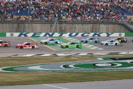 SPARTA, KY - JULY 13: Drivers race down the straightaway approach turn one during the Quaker State 400 presented by Walmart at Kentucky Speedway in Sparta, KY on July 13, 2019.(Photo by Ian Johnson/Icon Sportswire via Getty Images)