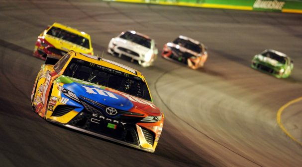 SPARTA, KY - JULY 13: Kyle Busch (18) Joe Gibbs Racing (JGR) Toyota Camry leads the field off of turn two during the Monster Energy NASCAR Cup Series Quaker State 400 presented by Walmart on July 13, 2019, at Kentucky Speedway in Sparta, Kentucky. (Photo by Michael Allio/Icon Sportswire via Getty Images)