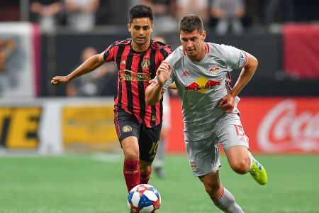 "ATLANTA, GA  JULY 07:  NewYork's Sean Nealis (15) takes the ball away from Atlanta's Gonzalo ""Pity"" Martínez (10) during the MLS match between the New York Red Bulls and Atlanta United FC July 7th, 2019 at Mercedes Benz Stadium in Atlanta, GA.  (Photo by Rich von Biberstein/Icon Sportswire via Getty Images)"