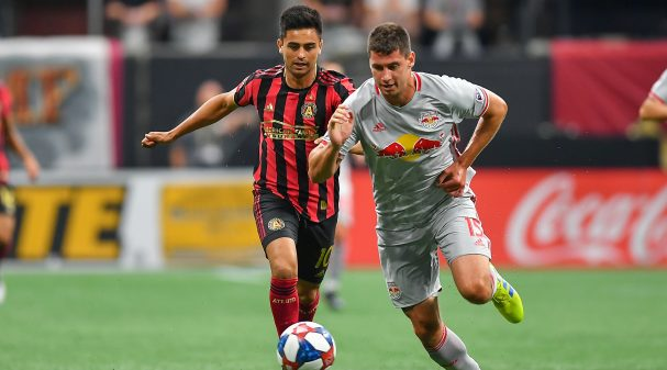 """ATLANTA, GA  JULY 07:  NewYork's Sean Nealis (15) takes the ball away from Atlanta's Gonzalo """"Pity"""" Martínez (10) during the MLS match between the New York Red Bulls and Atlanta United FC July 7th, 2019 at Mercedes Benz Stadium in Atlanta, GA.  (Photo by Rich von Biberstein/Icon Sportswire via Getty Images)"""
