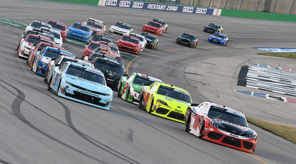 SPARTA, KY - JULY 12: Christopher Bell (20) Joe Gibbs Racing (JGR) Toyota Supra and Noah Gragson (9) JR Motorsports Chevrolet Camaro lead the field to a restart during the Alsco 300 on July 12, 2019, at Kentucky Speedway in Sparta, Kentucky. (Photo by Michael Allio/Icon Sportswire via Getty Images)