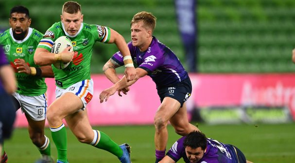 MELBOURNE, AUSTRALIA - MAY 30: George Williams of the Raiders gets by Cameron Munster of the Storm during the round three NRL match between the Melbourne Storm and the Canberra Raiders at AAMI Park on May 30, 2020 in Melbourne, Australia. (Photo by Quinn Rooney/Getty Images)