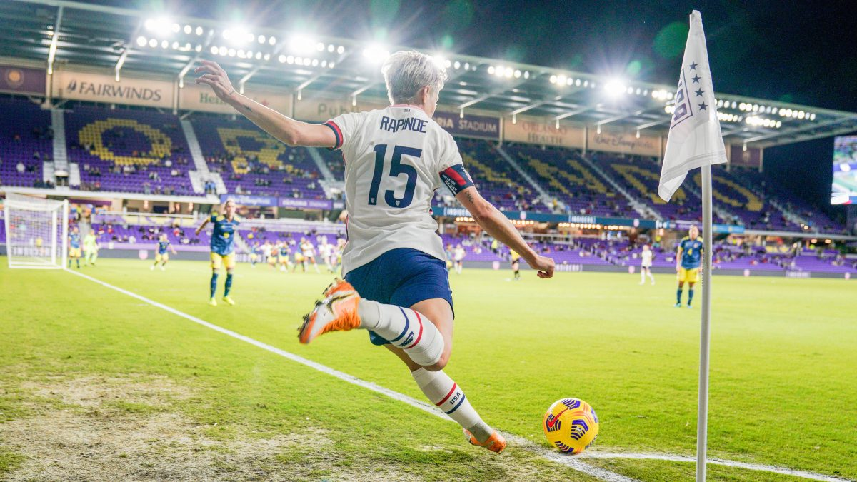 ORLANDO, FL - JANUARY 22: Megan Rapinoe #15 of the United States takes a cornerkick during a game between Colombia and USWNT at Exploria stadium on January 22, 2021 in Orlando, Florida. (Photo by Brad Smith/ISI Photos/Getty Images)