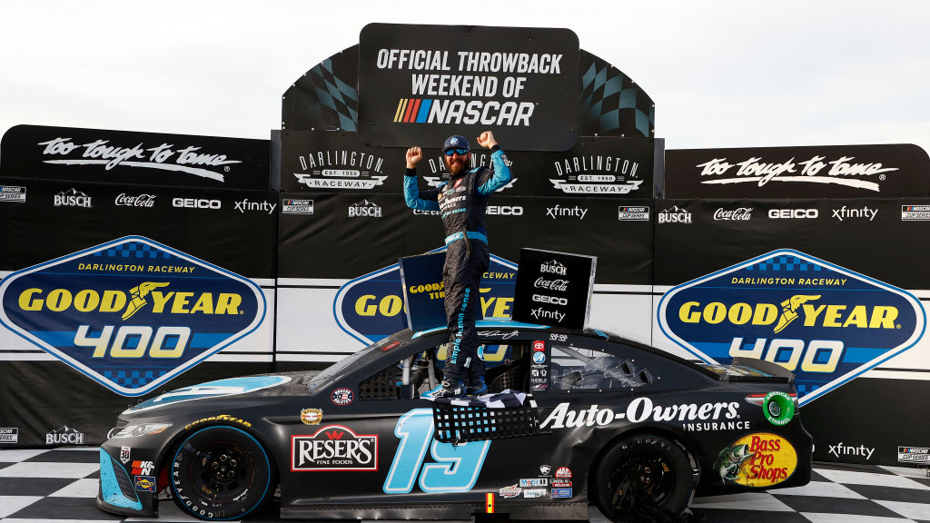 DARLINGTON, SOUTH CAROLINA - MAY 09: Martin Truex Jr., driver of the #19 Auto-Owners Insurance Toyota, celebrates in victory lane after winning the NASCAR Cup Series Goodyear 400 at Darlington Raceway on May 09, 2021 in Darlington, South Carolina. (Photo by Chris Graythen/Getty Images)