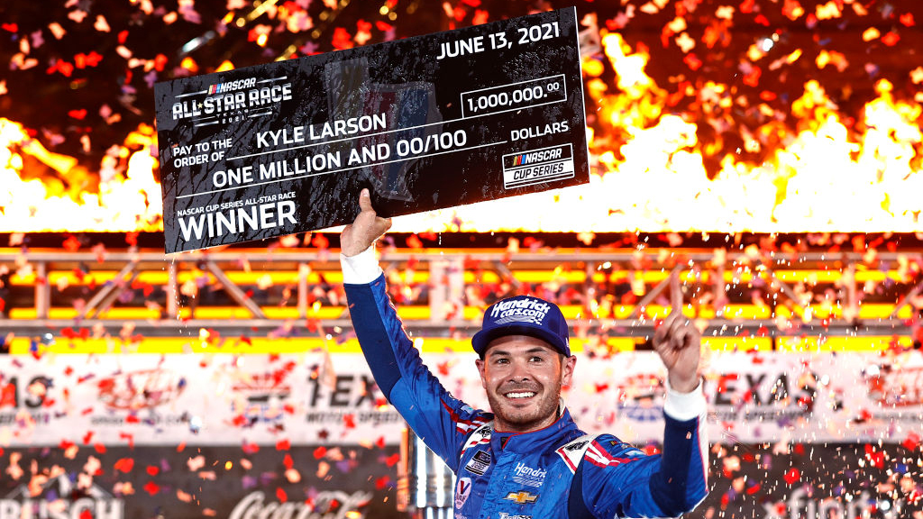 FORT WORTH, TEXAS - JUNE 13: Kyle Larson, driver of the #5 HendrickCars.com Chevrolet, celebrates in victory lane after winning  the NASCAR All-Star Race at Texas Motor Speedway on June 13, 2021 in Fort Worth, Texas. (Photo by Chris Graythen/Getty Images)